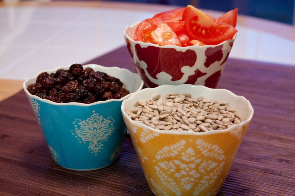 Tomatoes, Raisins and Sunflower Seeds in Cups